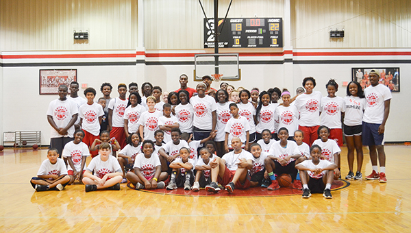 Corey Williams | The Brewton Standard Campers assemble at center court on the last day of basketball camp held at the T.R. Miller gymnasium. The two month camp was sponsored by the City of Brewton free of charge to all participants.