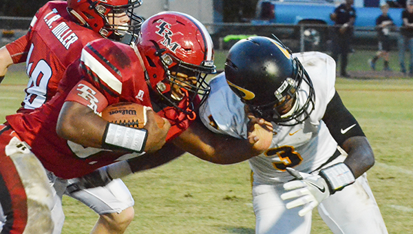 TRM running back Demarquis McMillan attempts to get by Opp defensive back Reggie Thompson. Mcmillan had 157 rushing yards in the Tigers loss Friday night.