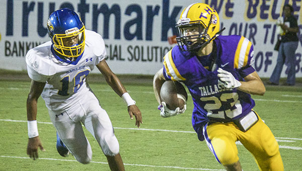 Tim Horton | The Wetumpka Herald W.S. Neal defensive back Marvin Maddox pursues Jamarcus Miller of Tallassee.