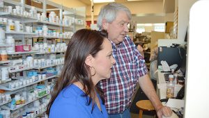 Nicole Burns | The Brewton Standard Brewton Medical Center Pharmacy owner Danny Cottrell and soon-to-be pharmacist Samantha Bell examines an incoming prescription.