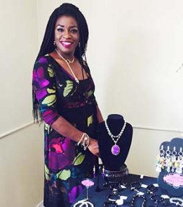 Courtesy photo Dr. Marcia Redmon Miles with a jewelry display.