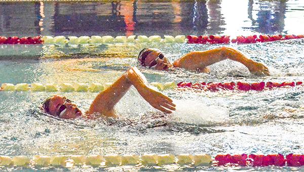 Corey Williams | The Brewton Standard Jocelyn Carpenter and Tiffany Reiss swim the 200 yard IM on Saturday.
