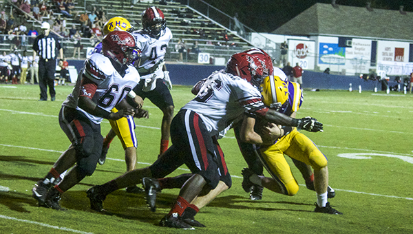 Courtesy photo Miller defenders pounce on a Tallassee ball carrier in Friday's win.
