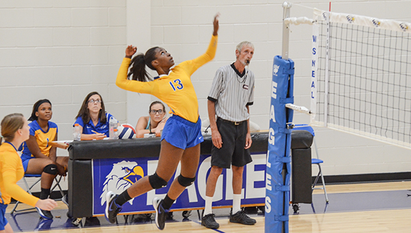 Corey Williams | The Brewton Standard Dinah Samuel of Neal goes up for the kill against Monroe on Thursday.