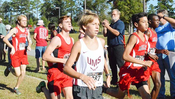 Stephanie Nelson | The Brewton Standard TRM's Tucker McDaniel, Micah Flores and Tailand Mitchell run on Saturday. The boy's team finished seventh overall.