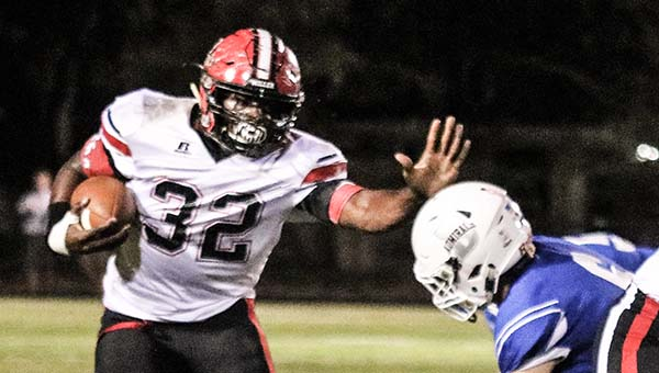 Photo by Allison Terrell T.R. Miller's Michael Campbell dodges a Bayside Academy defender Friday.