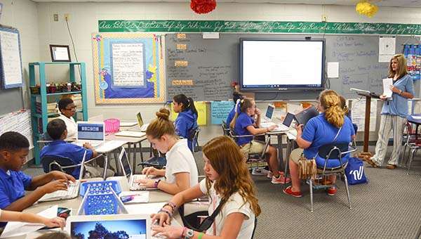 Corey Williams | The Brewton Standard Mrs. Andrea Salter's reading class at W.S. Neal Middle School work on chromebooks during a lesson.