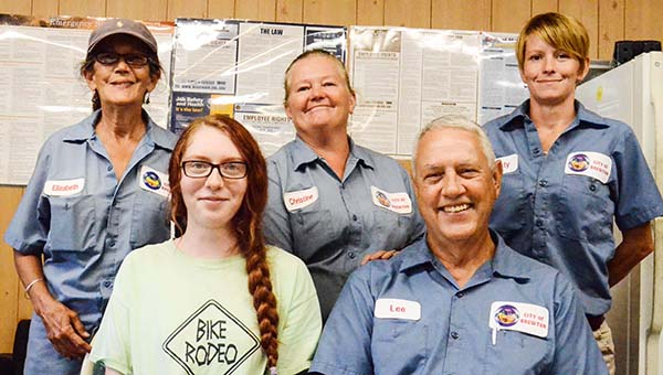 Lydia Grimes | The Brewton Standard Keepers of the plants and flowers from the Brewton Utility Department are, left to right, back row, Elizabeth Sutton, Christina Green and Misty Harmon; front row, from left, Jessica Cardwell and Lee McDonald.