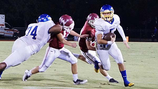 Heather Stone | The Brewton Standard Neal quarterback No. 5 Matt Hutchins takes off against UMS-Wright on Friday.
