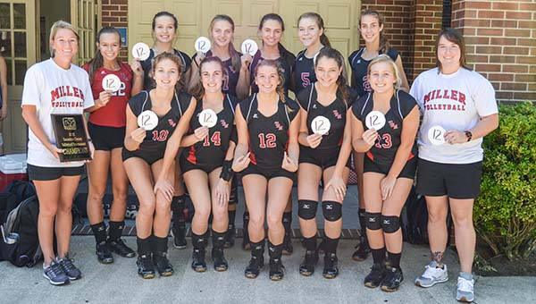 Corey Williams | The Brewton Standard The TRM volleyball varsity celebrate their 12th straight county title.