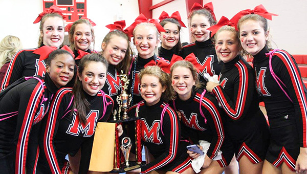 Courtesy photo The TRM cheerleaders pose with the trophy. Back row, from left-to-right: Mallori Floyd, Payton Baxtor, Madison Douglas, co-captain Tori Sims, Tori Knapp, Mary Madison Brown, Caitlyn Smith and Hannah Lisenby. Front row, left-to-right: Dejah Askew, Grace Ruzic, captain Mary Allison Peace and Anna Kate Brittain.