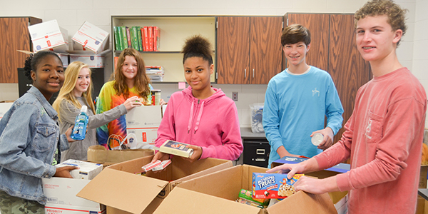 Corey Williams   The Brewton Standard Brewton Middle School students donated general items such as Q-tips, toothpaste and deodorant and also items such as beef jerky, candy and playing cards. Pictured making donations were eighth graders (from left-to-right) Sonnet Lane, Anna Watson, Sydney Adams, Jasmine Lovelace, Andrew Ray and Wyn Brittain.