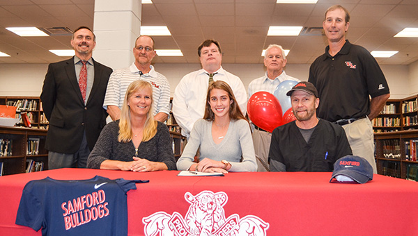 Corey Williams | The Brewton Standard Allie Nelson (center) signs with her parents, Dr. Scott Nelson and Pauline Nelson present. Also pictured from left-to-right is TRM principal Ron Snell, cross country assistant coach Alan Ash, TRM vice principal Doug Gerety, cross country volunteer coach Billy Bryant and TRM cross country coach Rob Atkinson.