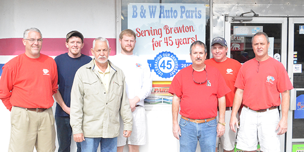 Corey Williams | The Brewton Standard Jack White (third from left) pictured with employees. His sons, Greg (far-left) and Steve (far-right) share managerial duties.