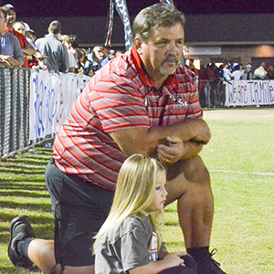 Corey Williams | The Brewton Standard Charlie German, with his granddaughter, is pictured on the TRM sideline.