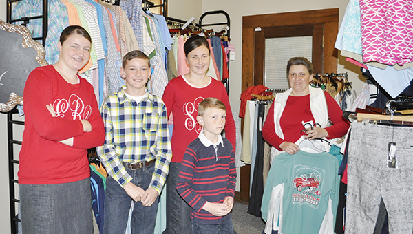 Stephanie Snodgrass | The Brewton Standard The Blair family was among those who turned out Thursday to participate in Brewton's downtown holiday kickoff. Here, the family shops inside Weaver's to stock up on items for the Christmas gift-giving season.