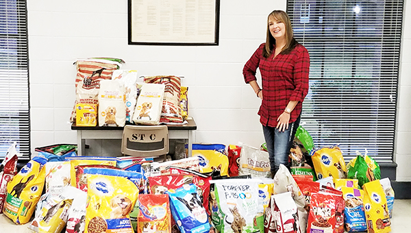 Nicole Burns | The Brewton Standard Jefferson Davis Community College History Professor Lisa Pace and the donated dog food.