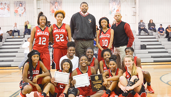 Corey Williams   The Brewton Standard Miller captured first place in the 2016 County tournament. Aleria Smith (sitted center) was named girl's MVP.