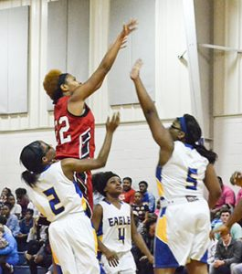 Corey Williams | The Brewton Standard TRM's Kyla Bell-Barton goes up for a shot against Neal.