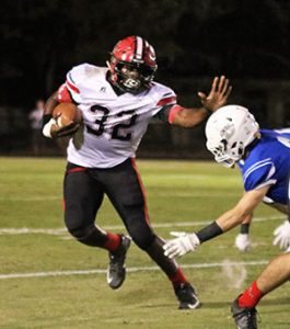 Photo by Allison Terrell Campbell rushes against Bayside Academy.
