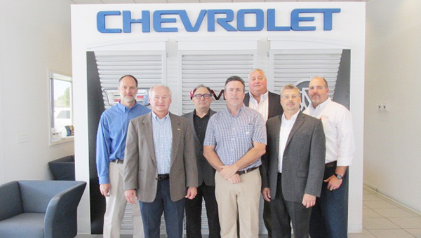 Stephanie Snodgrass | The Brewton Standard Wayne Roney (center in plaid) of Peach Chevrolet was recently congratulated on earning his GM World Class Technician certification by Chip Peach and other GM officials.