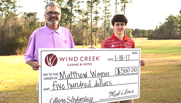 Stephanie Snodgrass| The Brewton Standard T.R. Miller golf athlete Matthew Wager was awarded a $500 scholarship for his volunteer efforts during the 2016 Hardees and Wind Creek Casino Collegiate tournament. Here, tourney director Mark Naes presents Wagner the check.