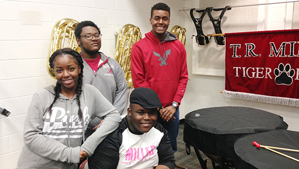 Stephanie Snodgrass | The Brewton Standard T.R. Miller band students Makayla Jones, Mark Hendrieth, Jordan Delawrence and Daniel Samuel pose with the new drums. Below: Ryder Jernigan with part of the TRM band percussion.