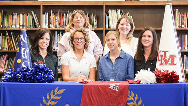 Corey Williams | The Brewton Standard W.S. Neal senior Adria Barnett signed her cheerleading scholarship at the University of Mobile last week. Attending the signing was: back row from left to right, grandmother, Joyce Emmons; and youth all-star coach, Jean Freeman. Front row from left to right, University of Mobile cheerleading coach, Kamie Whiteis; Barnett; mother, Karla Stacey; and step-mother, Laura Barnett. Not pictured is her father, Mike Barnett.