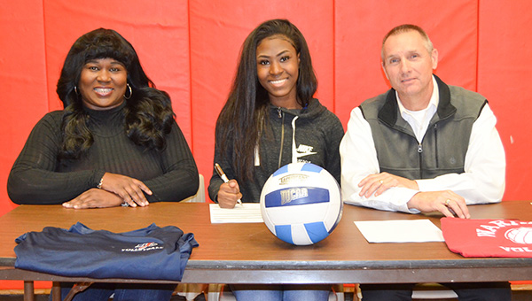 Corey Williams | The Brewton Standard W.S. Neal senior Dinah Samuel signs with the JDCC Lady Warhawks volleyball team this past Friday. Present at the signing was her mom, Karisky Samuel; and JDCC volleyball coach Steven Dickey.
