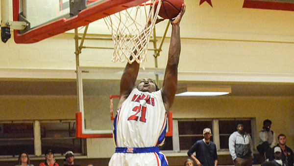 Corey Williams | The Brewton Standard JDCC's Richard Boggan slams down an alley-oop pass against LBW on Tuesday.