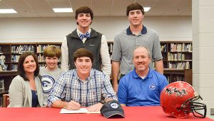 Corey Williams | The Brewton Standard Caleb Winton signs with Shorter University. Present was his family from left to right: mother, Rachel Winton; brother, Jonah Winton; brother, Noah Winton; brother, Joshua Winton; and father, Randy Winton.