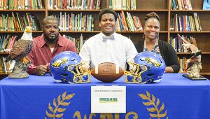 Corey Williams | The Brewton Standard Mitchell at the signing was his father, Tommy Jeremiya Mitchell; and mother, Okima Jones.