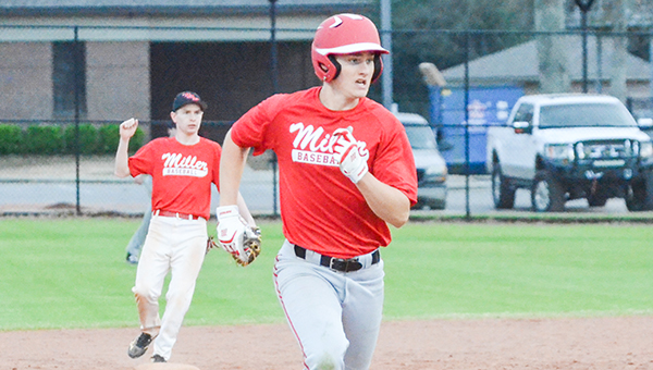 Corey Williams | The Brewton Standard TRM junior Drew Williamson heads for third base as TRM  second basement Baylen Parker looks on.